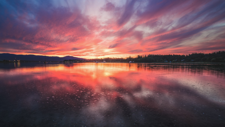 A colorful sunset reflected off Comox Harbor - Vancouver Island, Canada