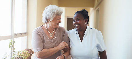 bigstock-Smiling-Home-Caregiver-And-Sen-129899141.jpg