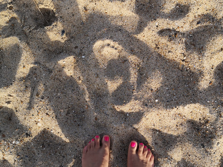 At the Beach: The Symbolism of Water and Sand