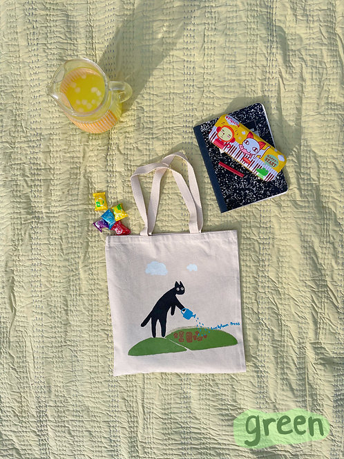an apple a day keeps the big cat away tote bag