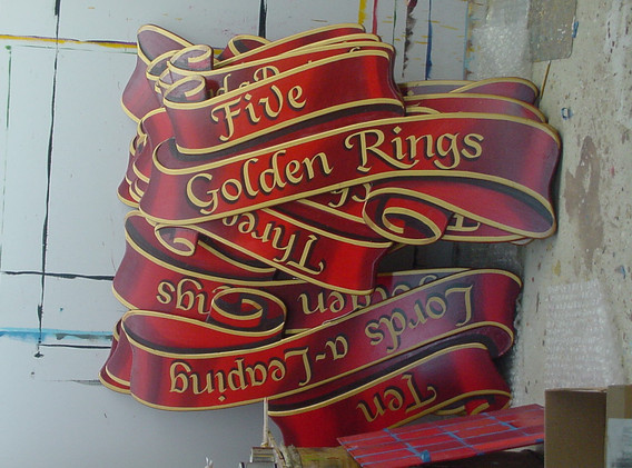 """Hand painted 'Twelve Days of Christmas"""" signs."""