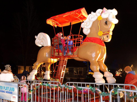 Giant 15ft rocking horse with holiday themed colors.