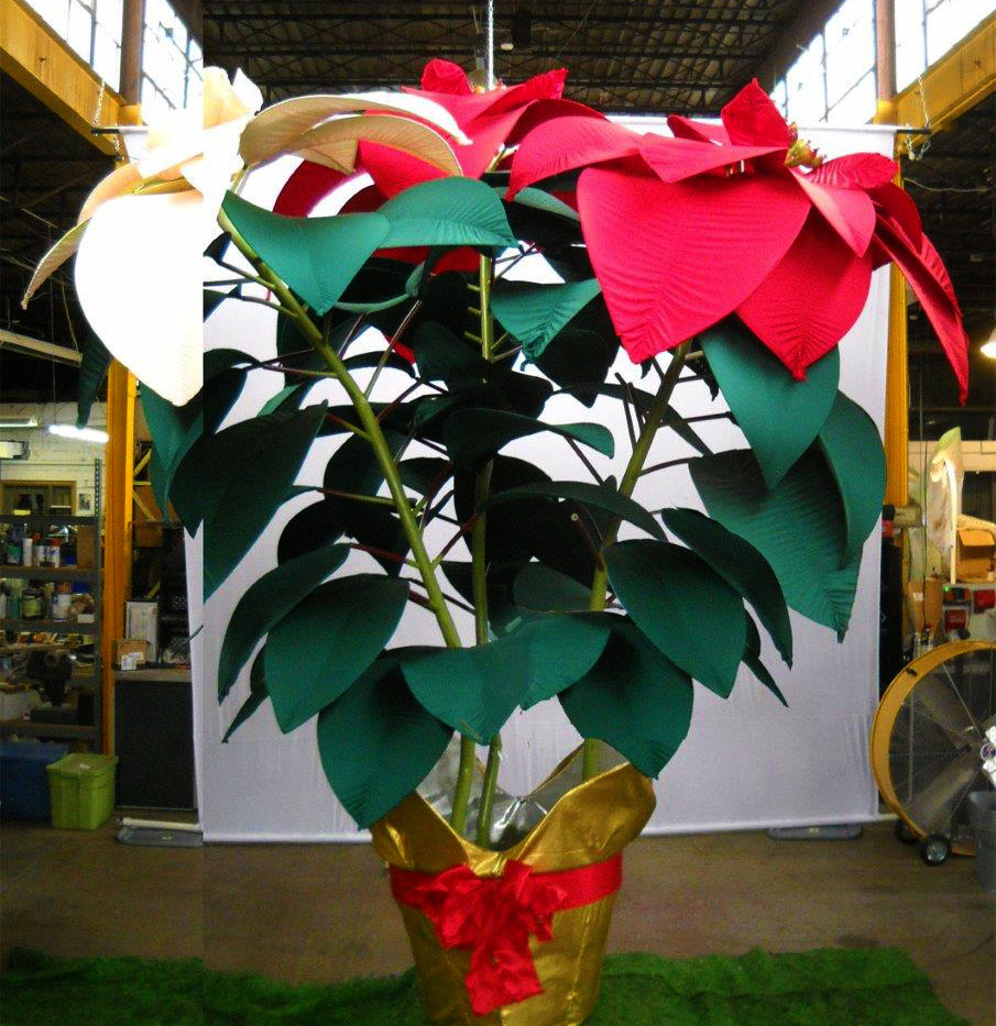 Giant fabric poinsettia available in a variety of colors.