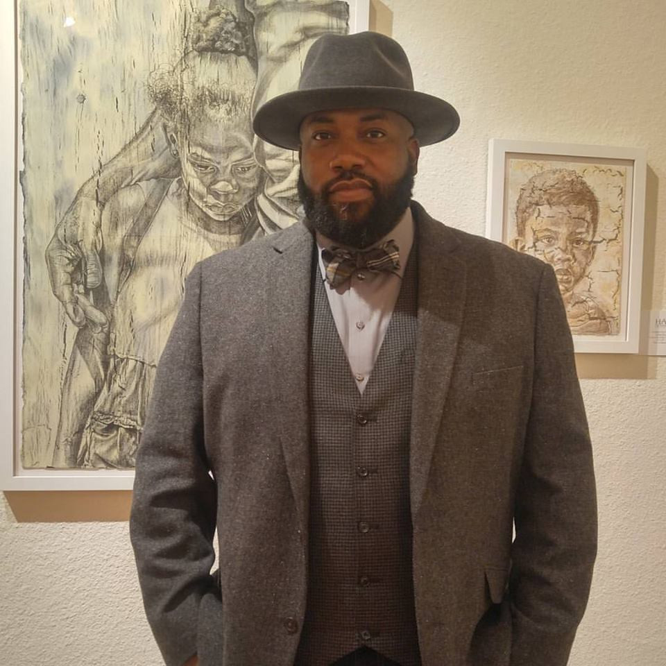 Standing proudly at the opening reception for the works on paper exhibition held on December 3rd.