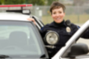 a female police officer smiling next to
