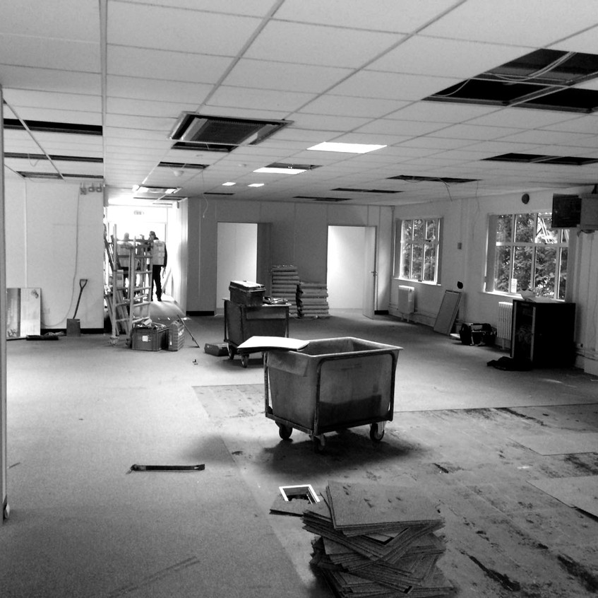 Carpets, ceiling tiles, interior air-conditioning unit and partitions in process of being removed
