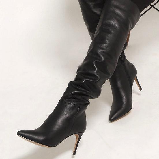 Високі чоботи з м'якої шкіри