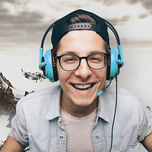Young Man with Headphones Playing Video