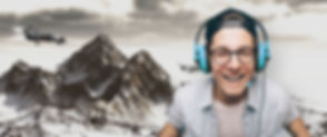 Young Man with Headphones Playing Video Game