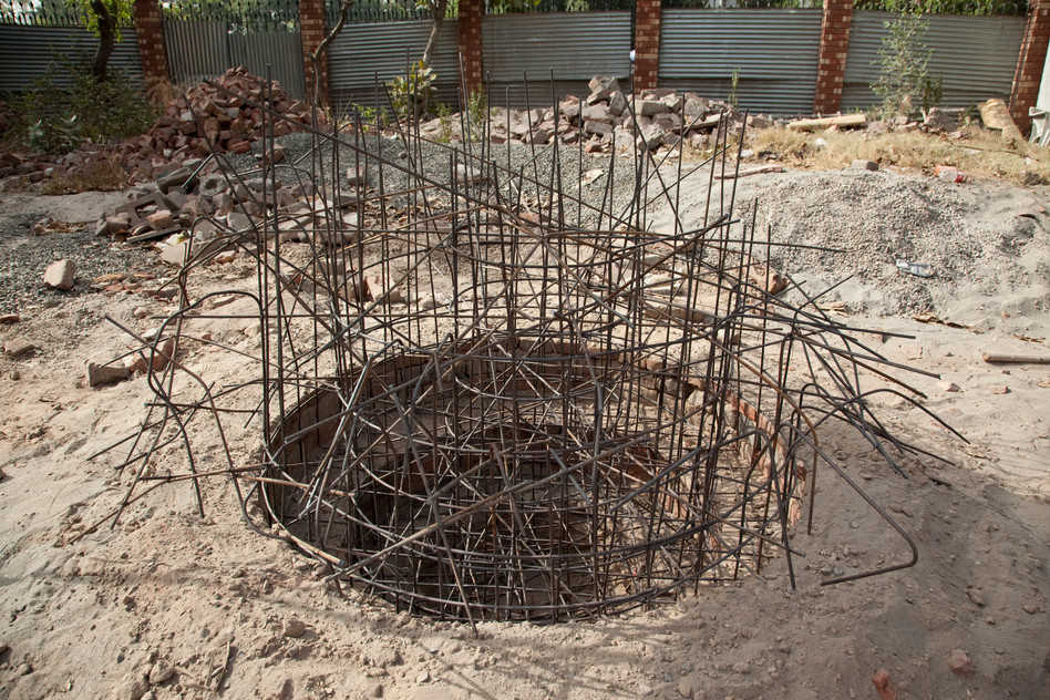 Metal rods, brick, and sand