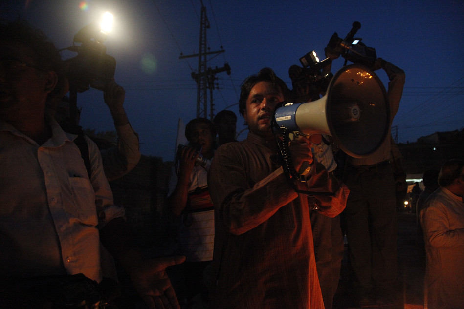 attiq ahmed at a vigil for violence in the city