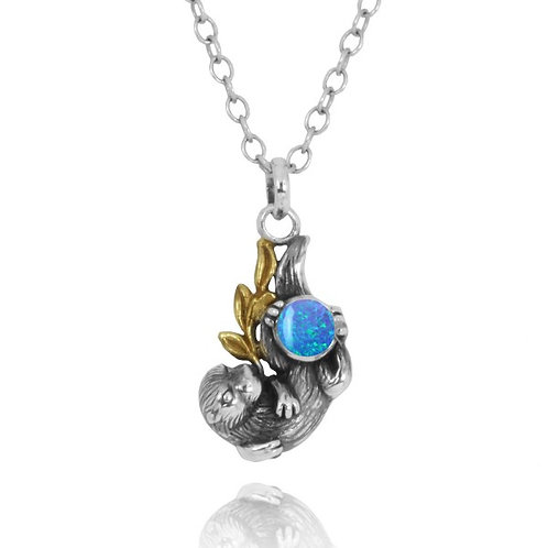 [NP12864-BLOP] Oxidized Silver Otter With Gold Holding Round Blue Opal Pendants