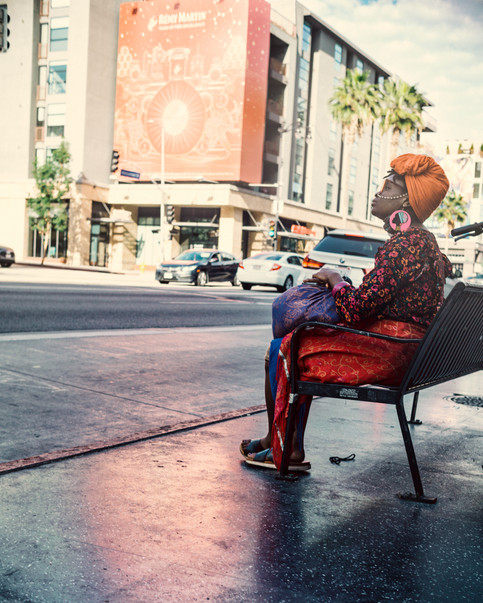 Scenes-African woman waiting for the bus