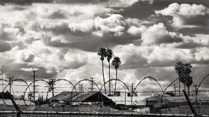 Insdustrial-LA junkyard and cloudy sky (