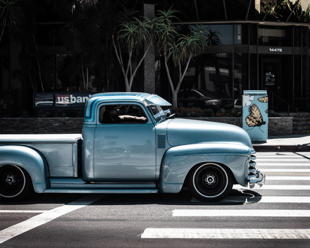 Vehicles-Blue hotrod chasing a butterfly