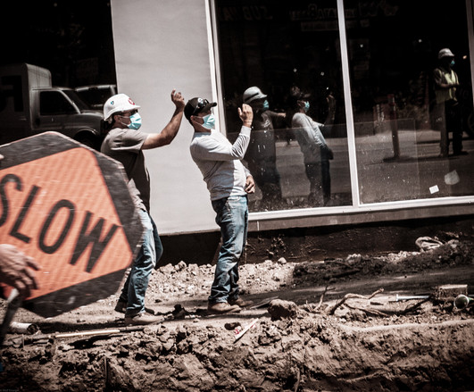 Road workers giving directions