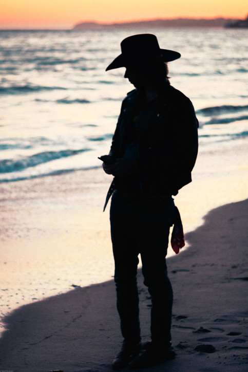 Scenes-Cowboy silhouette at the beach du