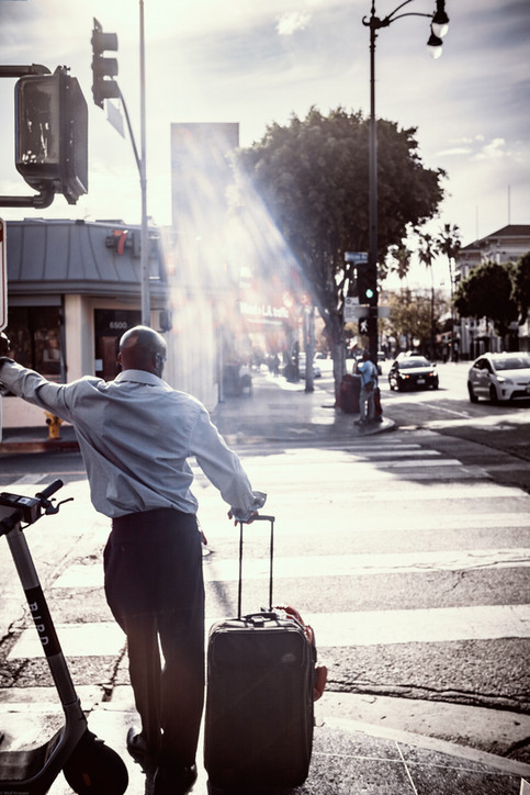 Scenes-Man in dress shirt with luggage w