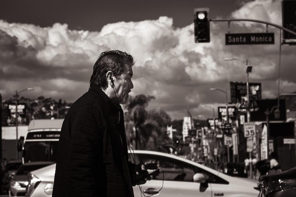 Pensive man crossing