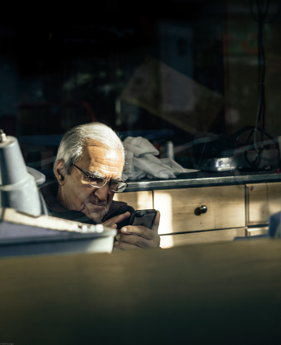 Scenes-Dry cleaner shop owner in the mor