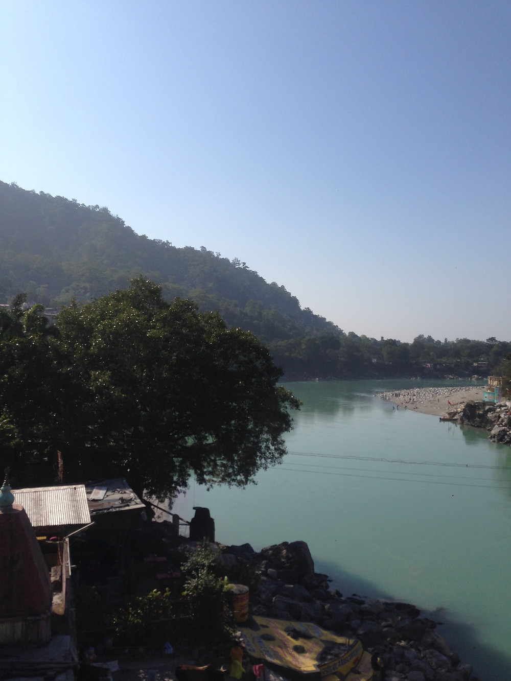 The breathtaking view of river Ganges meeting plains from Lakshman Jhulla