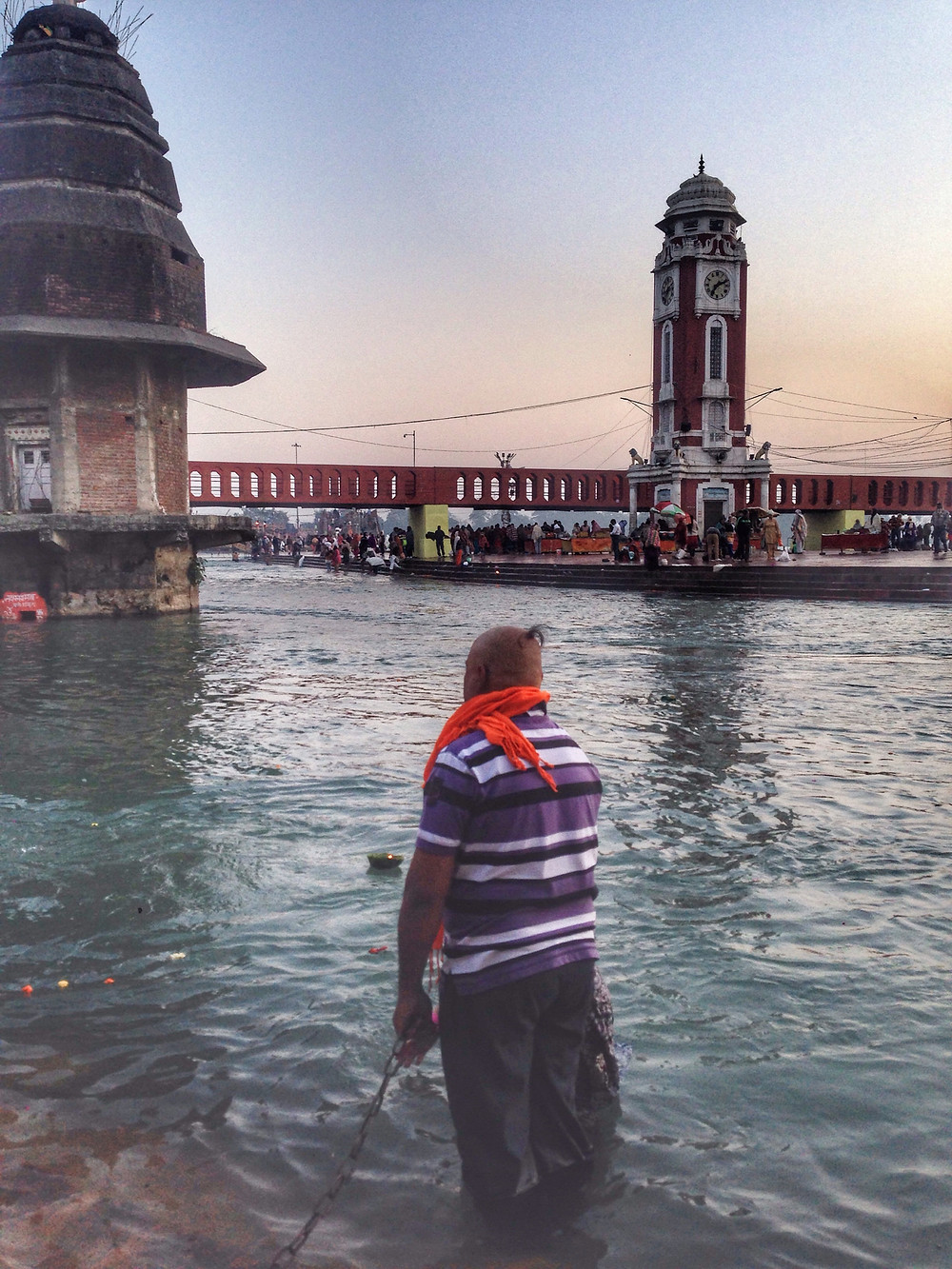 Devotees taking a dip in the holy river Ganges.