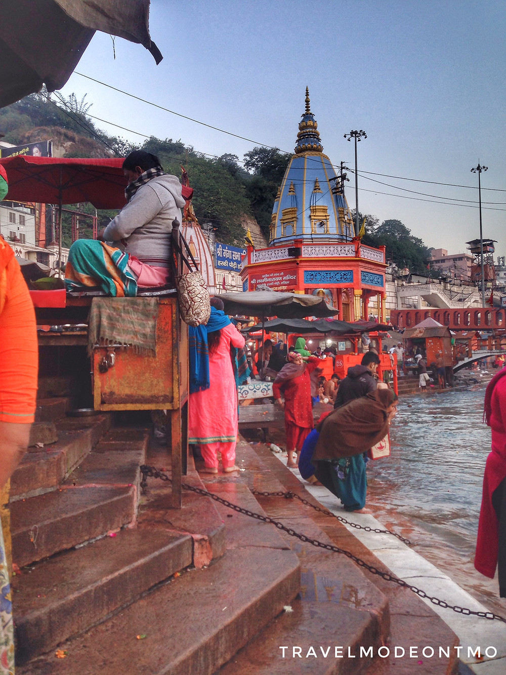 Devotees offering prayers and taking a dip in Holy River Ganges