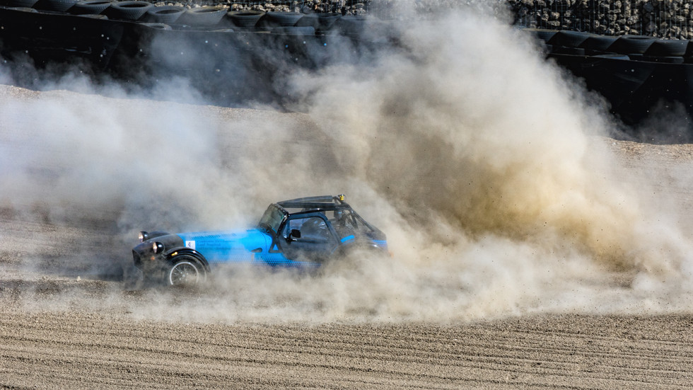 2018 Caterham skidding out into the gravel