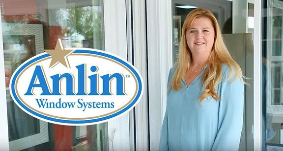 Photo - Juli Smiling with Anlin Logo.jpg