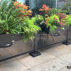 Restaurant Patio barriers at the vine, NY. HaSelect Space sidewalk barriers with railing planters full of flowers and plants.  The Vine restaurant, NY