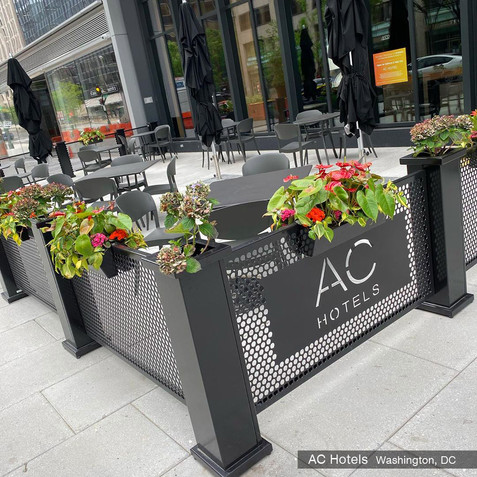 sidewalk cafe partitions with planters and a custom logo. AC Hotels, DC