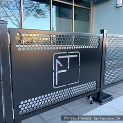 Sidewalk cafe gate with a custom lasercut logo. Fitness Therapy, CA