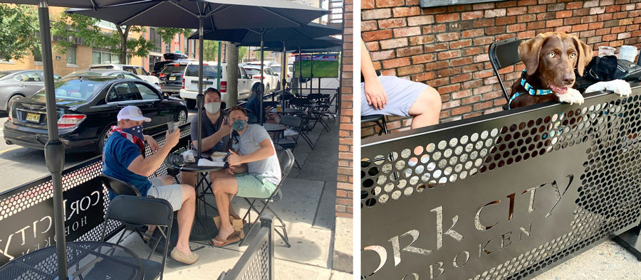 People enjoying drinks in a sidewalk cafe with SelectSpace Partitions