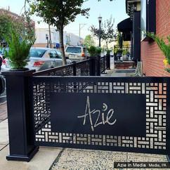 Restaurant patio partitions with lasercut logo panels