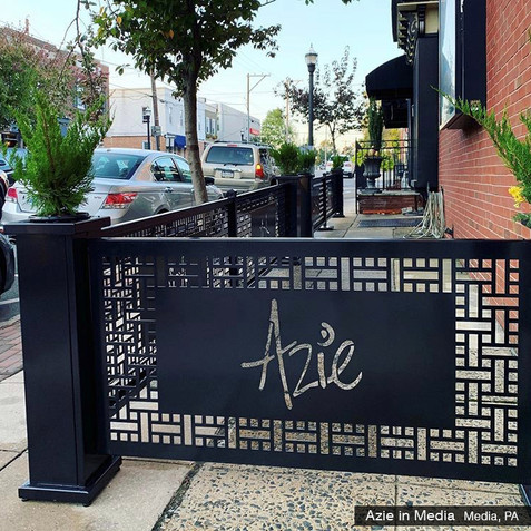 Restaurant patio partitions with lasercut logo panels