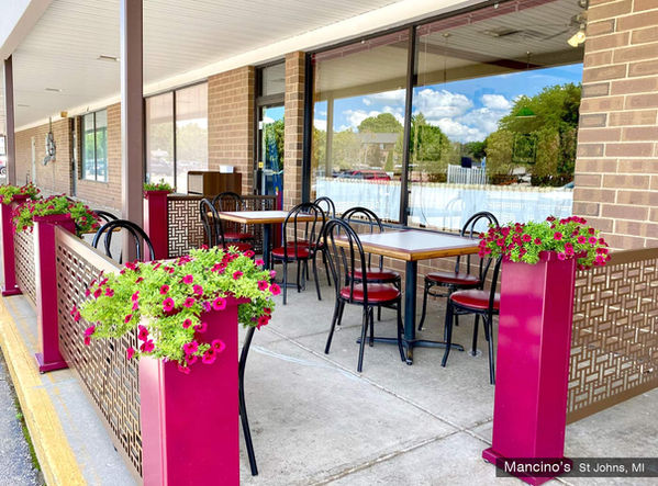 sidewalk cafe outdoor seating with planter partitions