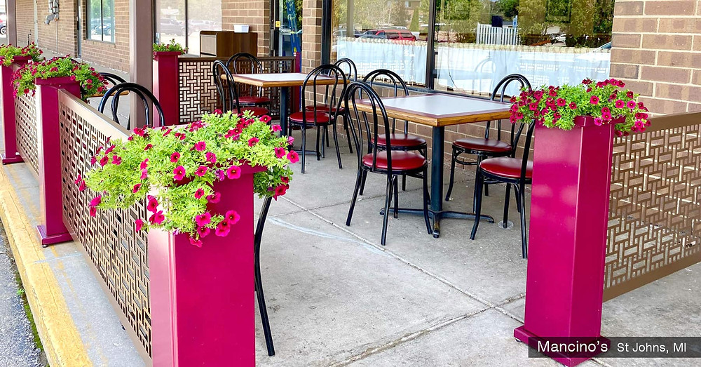 Brown patio partitions with fuchsia planter stands