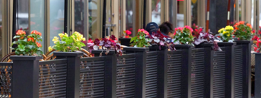 sidewalk cafe fencing with planters and flowers