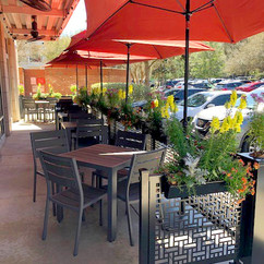 Sidewalk cafe dividers with planter stands and hanging planters