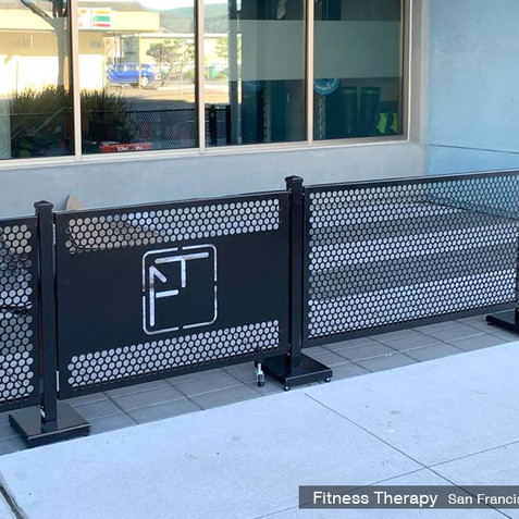Sidewalk cafe gate with a custom lasercut logo. Fitness Therapy, CA