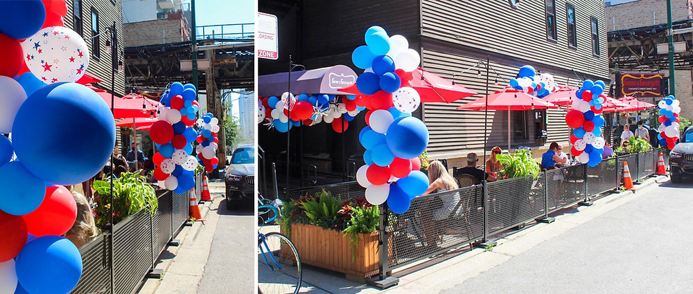 Pretty sidewalk cafe with bright red, white, and blue balloon decorations