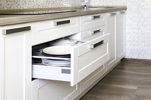Opened kitchen drawer with plates inside