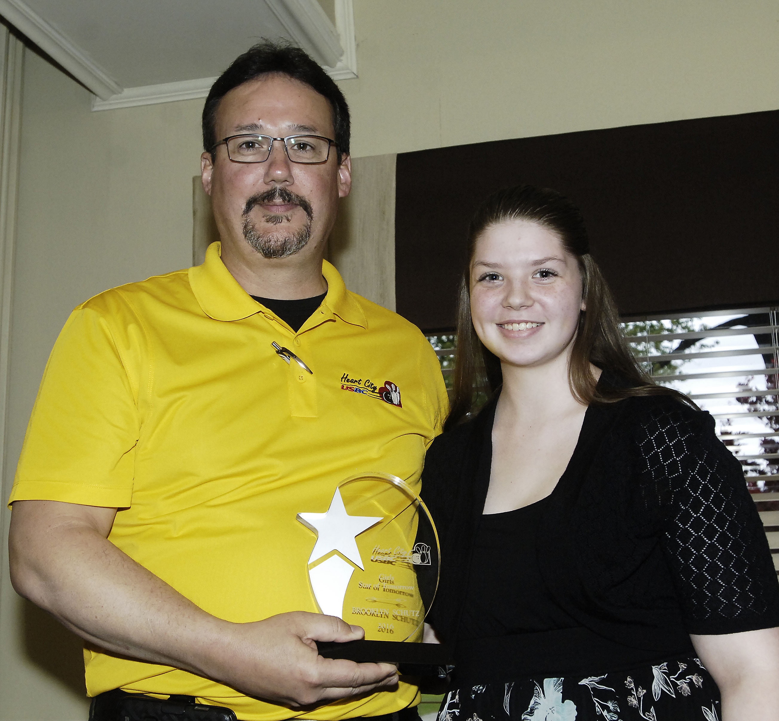 Brooklynn Schutz accepts award.jpg