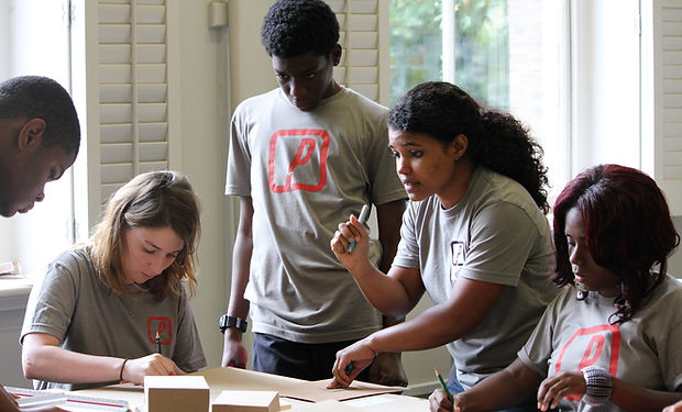 A group of Project Pipeline students collaborate on a project.