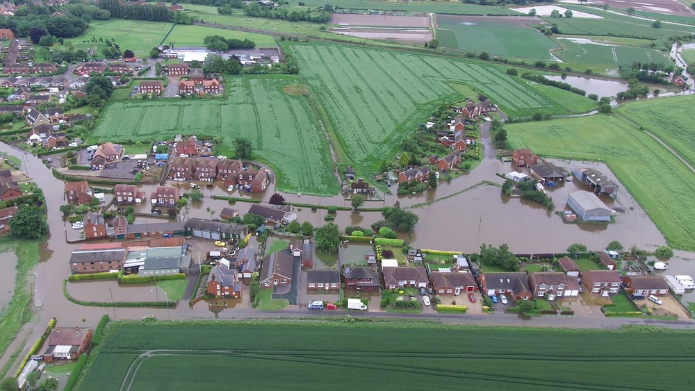 Houses flooded by the river Steeping in Wainfleet, Lincolnshire June 2019