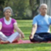 Senior indian couple yoga meditation Taj Residences living room a luxury gated retirement community gated active adults