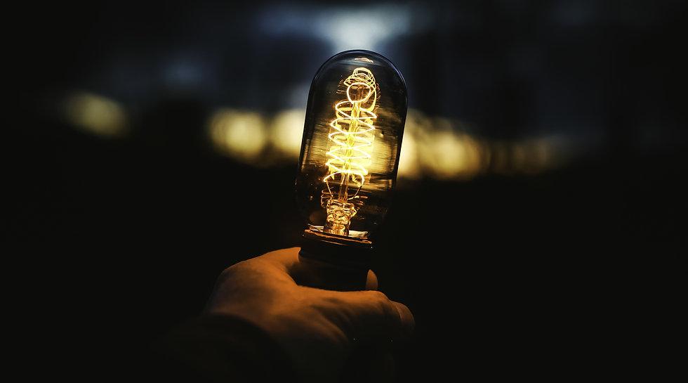 closeup-shot-of-human-hand-holding-lamp.
