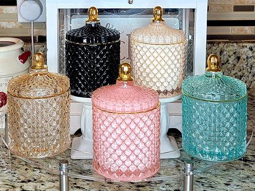 Elegant glass jar with gold trim candles