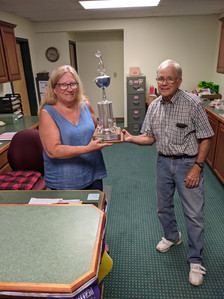 Fred Brandon and Dawn Dawson of 1st Baptist of HdG found the revolving champion trophy from 1993