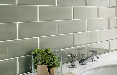 Grey gloss bathroom wall tiles in a trad